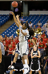March 27, 2010; Sacramento, CA, USA; Xavier Musketeers forward Amber Harris (11) wins the opening tipoff from Gonzaga Bulldogs forward Vivian Frieson (12) during the first half in the semifinals of the Sacramental regional in the 2010 NCAA womens basketball tournament at ARCO Arena.  Xavier defeated Gonzaga 74-56.