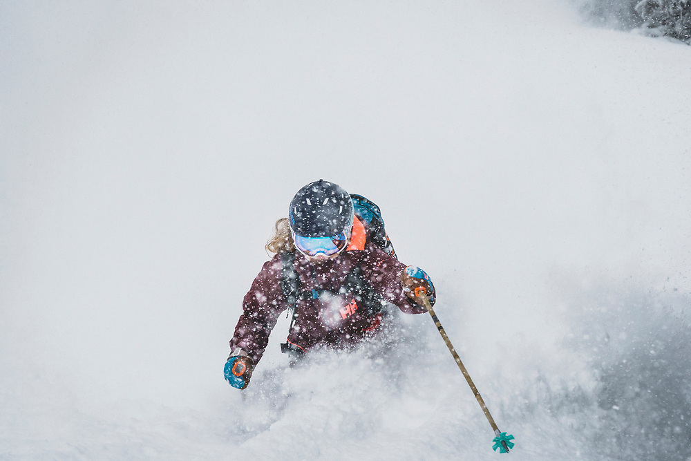 April showers bring late season powder days. Kaylin Richardson skiing deep in the spring swing of things, Grizzly Gulch, Wasatch Range, Utah.