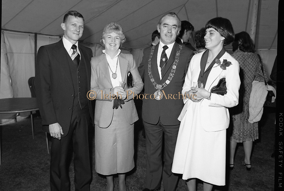 Guests and staff at the US Embassy in Phoenix Park, Dublin, celebrate American Independence Day..1980-07-04.4th July 1980.04/07/1980.07-04-80..Photographed at the US Ambassador's Residence,  Phoenix Park...Guests and staff at the US Embassy in Phoenix Park, Dublin, celebrate American Independence Day..1980-07-04.4th July 1980.04/07/1980.07-04-80..Photographed at the US Ambassador's Residence,  Phoenix Park...Fergus O'Brien, the mayor of Dublin and his wife (centre) pose for the camera with other guests in the marquee during festivities.