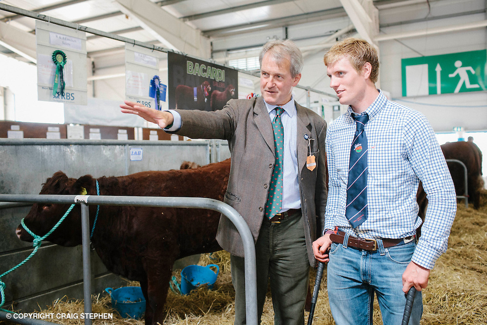 Royal Highland Show, 2014. Owen Paterson, Sec of state for environment, food & rural affairs in the cattle hall. PAYMENT TO CRAIG STEPHEN 07905 483532