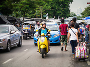 30 MAY 2013 - BANGKOK, THAILAND:   Traffic on Krung Kasem Rd in Bobae Market in Bangkok. Bobae Market is a 30 year old famous for fashion wholesale and is now very popular with exporters from around the world. Bobae Tower is next to the market and  advertises itself as having 1,300 stalls under one roof and claims to be the largest garment wholesale center in Thailand.   PHOTO BY JACK KURTZ