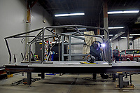 Eastern Rod and Customs' welder works on SolarPack's car.