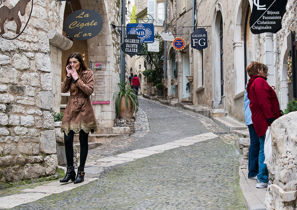Latest fashion and tension on the left. Leisure on the right. Saint Paul village, France.
