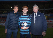 Monifieth High's Ewan Stewart, who scored the two goals which beat Grove Academyl, is presented with the man of the match award by Dundee FC's Cammy Kerr and Dave Forbes of sponsors DFCSS after the Senior Schools Cup final at Dens Park, Dundee, Photo: David Young<br /> <br />  - &copy; David Young - www.davidyoungphoto.co.uk - email: davidyoungphoto@gmail.com