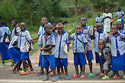 Rwanda education system operates on a 6-3-3-4 system, with 6 years at primary shool, 3 year at junior secondary, 3 year at senior secondary, and 4 years university Bachelor degree. Her we see some very happy pupils from primary school, probably on their way home after a day at school | Barneskuleelever fra Rwanda.