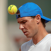 PARIS, FRANCE May 24. Rafael Nadal of Spain heads the ball while practicing on Court Philippe-Chatrier in preparation for the 2019 French Open Tennis Tournament at Roland Garros on May 24th 2019 in Paris, France. (Photo by Tim Clayton/Corbis via Getty Images)