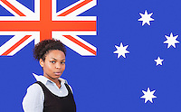 Young African American businesswoman smiling over Australian flag
