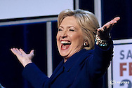 "Democratic presidential candidate Hillary Clinton gestures as she walks on stage at a Democratic fundraising dinner featuring all three candidates in Las Vegas, Nevada January 6, 2016.  REUTERS/Rick Wilking/File Photo                  FROM THE FILES PACKAGE ""THE CANDIDATES"" - SEARCH CANDIDATES FILES FOR ALL 90 IMAGES - RTX2SFFP"