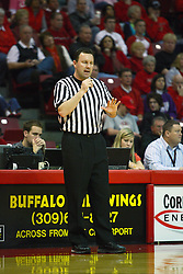 12 February 2011: Referee Brad Gaston talks to the Redbird bench just before issuing a warning to coach Tim Jankovich during an NCAA Missouri Valley Conference basketball game between the Missouri State Bears and the Illinois State Redbirds at Redbird Arena in Normal Illinois.