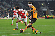 Mohamed Elneny of Arsenal FC (35) and Nick Powell of Hull City (22) during the The FA Cup fifth round match between Hull City and Arsenal at the KC Stadium, Kingston upon Hull, England on 8 March 2016. Photo by Ian Lyall.