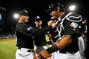 NEW TAIPEI CITY, TAIWAN - NOVEMBER 15:  Andy Skeels manager of Team New Zealand greets Beau Bishop #35 during player introductions before Game 2 of the 2013 World Baseball Classic Qualifier against Team Chinese Taipei at Xinzhuang Stadium in New Taipei City, Taiwan on Thursday, November 15, 2012.  Photo by Yuki Taguchi/WBCI/MLB Photos
