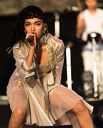 © Licensed to London News Pictures. 28/06/2015. Pilton, UK. FKA Twigs performing at Glastonbury Festival 2015 on Sunday Day 5 of the festival on the John Peel Stage stage.  FKA Twigs is Tahliah Debrett Barnett.  This years headline acts include Kanye West, The Who and Florence and the Machine, the latter being upgraded in the bill to replace original headline act Foo Fighters.  Photo credit: Richard Isaac/LNP