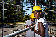 Philadelphia, Pennsylvania - September 17, 2015: Stage hands Lamar Beasley, from Lindenwolt, NJ, and Ronnie DePamphilis, jr, South Philadelphia, build the media riser for Pope Francis's visit to Philadelphia.<br /> <br /> <br /> Scott Mirkin's company ESM is heading the production of The World Meeting Of Families and Pope Francis's visit to Philadelphia this Fall. The events will take place along the Benjamin Franklin Parkway.<br /> <br /> CREDIT: Matt Roth for The New York Times<br /> Assignment ID: 30179397A