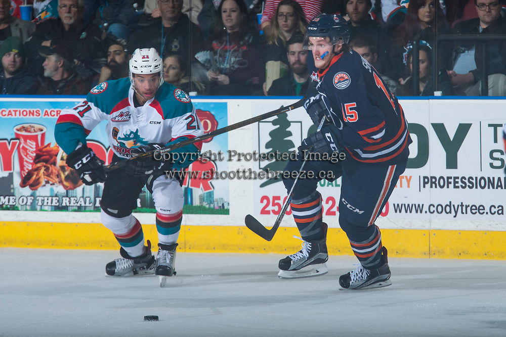 KELOWNA, CANADA - MARCH 25: Devante Stephens #21 of the Kelowna Rockets checks Collin Shirley #15 of the Kamloops Blazers on March 25, 2017 at Prospera Place in Kelowna, British Columbia, Canada.  (Photo by Marissa Baecker/Shoot the Breeze)  *** Local Caption ***