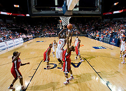 Virginia center Aisha Mohammed (33) shoots over N.C. State forward Khadijah Whittington (1).  The Virginia Cavaliers faced NC State Wolfpack women's basketball team at the John Paul Jones Arena in Charlottesville, VA on February 1, 2008.