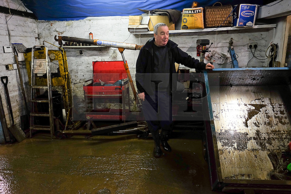 &copy; Licensed to London News Pictures. 29/12/15<br /> York, UK. <br /> <br /> Peter Hale begins the clean up at his flooded motor engineering business as flood water begins to subside on Huntington Road in York. Further rainfall is expected over coming days as Storm Frank approaches the east coast of the country.<br /> <br /> Photo credit : Ian Forsyth/LNP