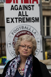 © Licensed to London News Pictures . 24/03/2018. Birmingham, UK. JULIE HAMBLETON leader of Justice4the21 campaign at the Democratic Football Lads Alliance demonstration, held at the same time as an FLA - Football Lads Alliance - demonstration against Islam and extremism , in Birmingham City Centre . Offshoot group, The True Democratic Football Lads Alliance, also hold a separate demonstration . Photo credit: Joel Goodman/LNP