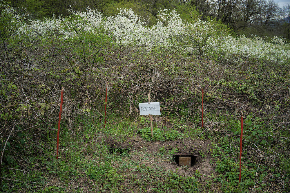 HAGOB KAMARI, NAGORNO-KARABAKH - APRIL 20: A sign marks the storage location of TNT, which is used to destroy land mines and any unexploded ordnance found by land mine clearance charity HALO Trust, on April 20, 2015 in Hagob Kamari, Nagorno-Karabakh. Since signing a ceasefire in a war with Azerbaijan in 1994, Nagorno-Karabakh, officially part of Azerbaijan, has functioned as a self-declared independent republic and de facto part of Armenia, with hostilities along the line of contact between Nagorno-Karabakh and Azerbaijan occasionally flaring up and causing casualties. (Photo by Brendan Hoffman/Getty Images) *** Local Caption ***