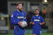 AFC Wimbledon midfielder Scott Wagstaff (7) holding ball during the EFL Sky Bet League 1 match between AFC Wimbledon and Burton Albion at the Cherry Red Records Stadium, Kingston, England on 28 January 2020.