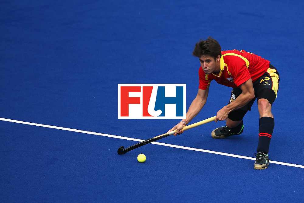 RIO DE JANEIRO, BRAZIL - AUGUST 11:  Josep Romeu #23 of Spain passes against Belgium during a Men's Preliminary Pool A match on Day 6 of the Rio 2016 Olympics at the Olympic Hockey Centre on August 11, 2016 in Rio de Janeiro, Brazil.  (Photo by Sean M. Haffey/Getty Images)