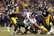Ziggy Hood (96) and Lawrence Timmons (94) of the Pittsburgh Steelers make a stop against Ray Rice (27) of the Baltimore Ravens in the AFC Divisional Playoff game on Jan. 15, 2011 at Heinz Field in Pittsburgh, Pennsylvania. The Steelers won 31-24. (Photo by Joe Robbins)