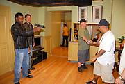 """Tyson Beckford and Simon Rex rehearsing a gun battle on the set of """"Hotel California"""""""