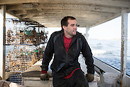 Chris Shipley patiently waits to drop the crab traps into a new location in the Chesapeake Bay | October 11, 2015