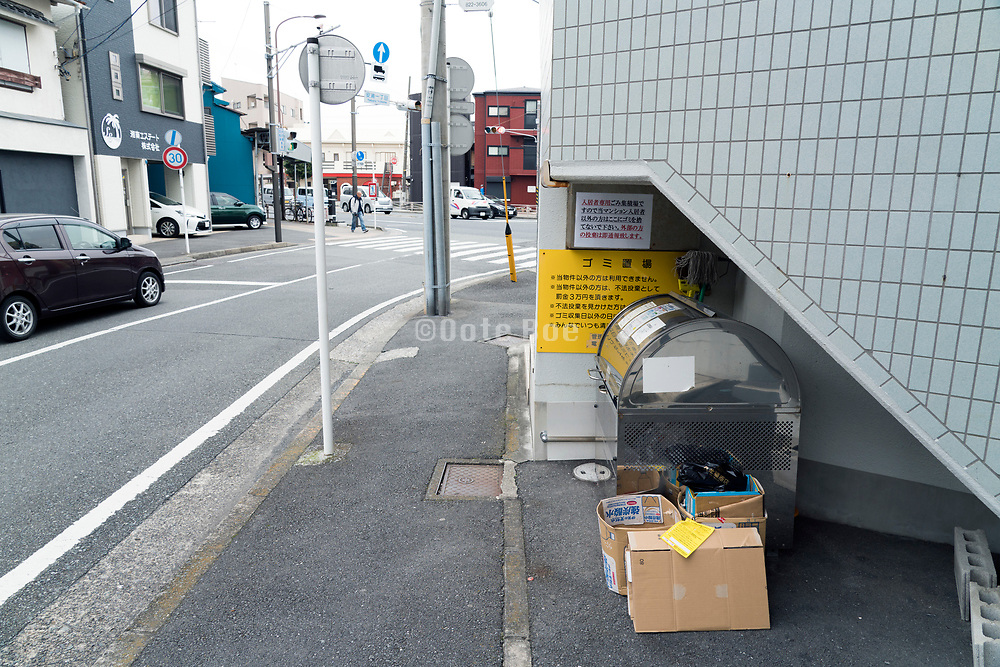 flat building outdoors trash bin for roadside garbage pick up Japan