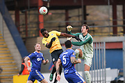 FC Halifax Town goalkeeper Sam Johnson (1) goes to punch the ball under pressure from Dover Athletic forward Inih Effiong (12) during the Vanarama National League match between FC Halifax Town and Dover Athletic at the Shay, Halifax, United Kingdom on 17 November 2018.
