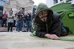 © licensed to London News Pictures. London, UK 01/05/2012. A protester posing in a tent as Occupy London protesters gathering at Paternoster Square, outside London Stock Exchange, before their march for May Day in London. Photo credit: Tolga Akmen/LNP