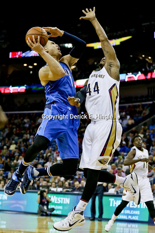 Jan 6, 2016; New Orleans, LA, USA; Dallas Mavericks forward Dwight Powell (7) is called for an offensive foul as he attempts a shot over New Orleans Pelicans forward Dante Cunningham (44) during the first quarter of a game at the Smoothie King Center. Mandatory Credit: Derick E. Hingle-USA TODAY Sports