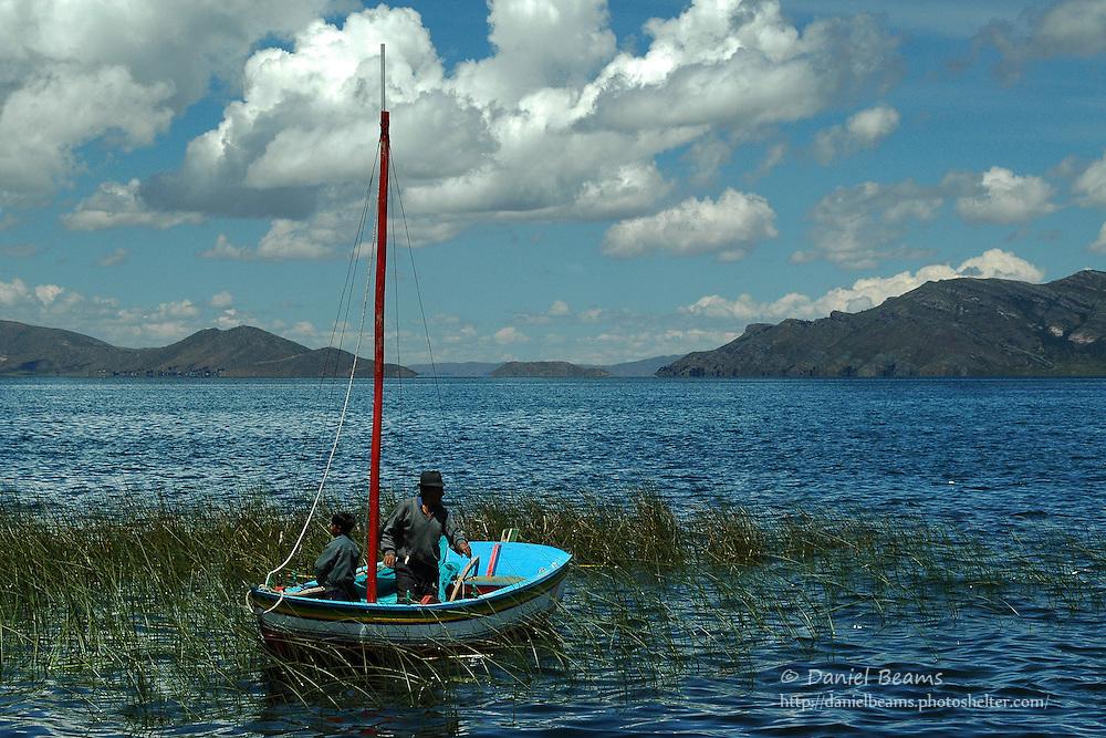 Fishermen on boat in Lago Titicaca, La Paz, Bolivia