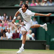 LONDON, ENGLAND - JULY 14: Marin Cilic of Croatia in action against Sam Querrey of the United States in the Gentlemen's Singles Semi-final of the Wimbledon Lawn Tennis Championships at the All England Lawn Tennis and Croquet Club at Wimbledon on July 14, 2017 in London, England. (Photo by Tim Clayton/Corbis via Getty Images)