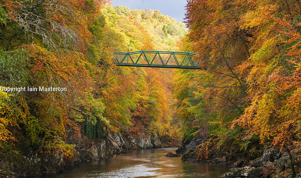 Spectacular autumn colours surround a small footbridge crossing the River Garry at Killiecrankie, the famous Perthshire beauty spot.