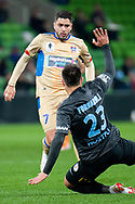 Melbourne City forward Bruno Fornaroli (23) defends the ball against Newcastle Jets forward Dimitri Petratos (7) at the FFA Cup Round 16 soccer match between Melbourne City FC v Newcastle Jets at AAMI Park in Melbourne.