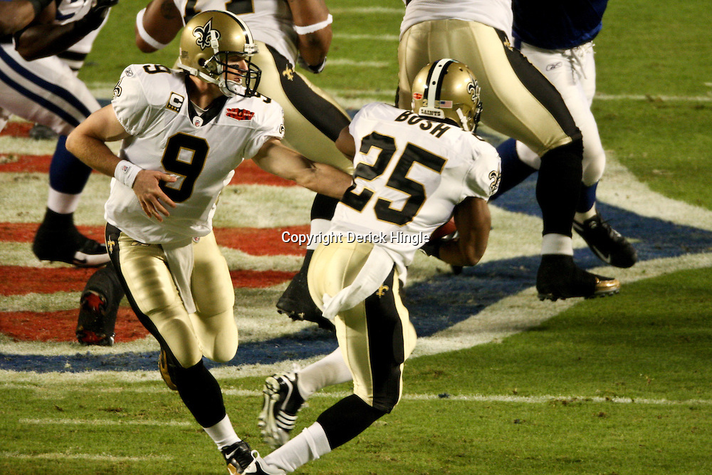 2010 February 07: New Orleans Saints quarterback Drew Brees (9) hands off to running back Reggie Bush (25) during a 31-17 win by the New Orleans Saints over the Indianapolis Colts in Super Bowl XLIV at Sun Life Stadium in Miami, Florida.
