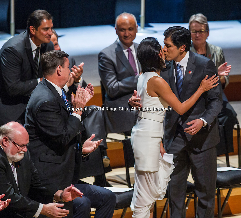 Democratic Sen. Kevin de Leon, the 47th President pro Tempore of the California State Senate, shares a kiss with his daughter Lluvia Carrasco in his inauguration, Wednesday, October. 15, 2014, in Los Angeles, California.  de Leon has been sworn in as the first Latino to head the California Senate in more than a century with an expensive and out-of-the-ordinary soiree in downtown Los Angeles. The Wednesday night ceremony was held at Walt Disney Concert Hall with an estimated price tag of $50,000, unlike previous, usually low-key ceremonies at the state Capitol.<br />  (Photo by Ringo Chiu/PHOTOFORMULA.com)