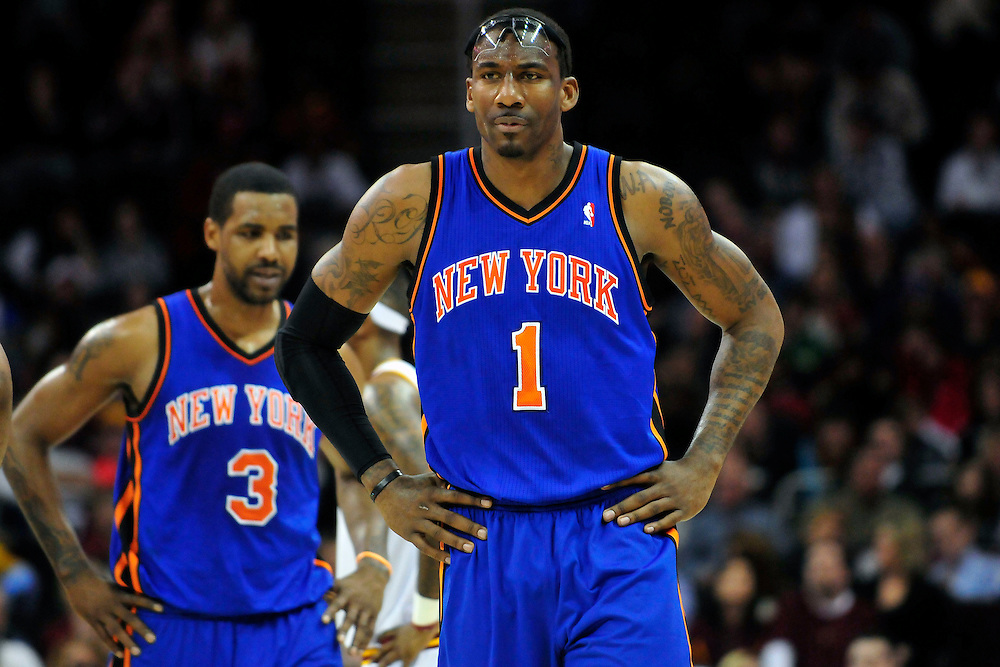 Feb. 25, 2011; Cleveland, OH, USA; New York Knicks power forward Amare Stoudemire (1) and small forward Shawne Williams (3) walk down court during a time out against the Cleveland Cavaliers during the second quarter at Quicken Loans Arena. Mandatory Credit: Jason Miller-US PRESSWIRE