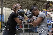 Namibia Flores with one of his students. not being able to compete she holds workshops. numbers of foreign women come to train with her<br /> <br /> The Cuban boxing has a centennial long prestigious history written by exceptional champions, artists of the ring, whose legendary exploits , continue to live in the stories of fans. In 1962 Cuba had abolished professionalism in sports. Two years ago, driven by economic interests and attempt to stop the bleeding of athletes on the run from the island, sports authorities have announced participation in world boxing championship, the World Series of Boxing (WSB), which are not however a professional circuit because they remain part of the Olympic boxing. Thanks to a law passed a few years ago, with new economic conditions for the Cuban athletes, now, in addition to the contributions they receive from the state, the Cuban boxers will earn from their sport, 80% of the proceeds from participation in<br /> international sporting events. Another revolution in the land of revolutionary socialist utopia , now more and more on the road of the disintegration waiting for another revolution in the Cuban boxing that will allow women to have a women&rsquo;s boxing team. Revolution for which for years has fought Namibia Flores whose dream is to participate in the Olympics with the colors of his country. A fight against time for the forty Namibia Flores. A dream that will probably remain so for reached the age limit.<br /> Namibia has refused to fight for the US teams. Most likely it will not fight the next Olympics in Rio but it is determined to help future Cuban fighters to practice the sport which they love.