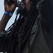 Junior Kava jah Johnson from the Reggae band i-KRONIK performs on stage during The 19th Annual Bob Marley People's Festival Saturday, July 27, 2013, at Tubman-Garrett Riverfront Park in Wilmington Delaware.