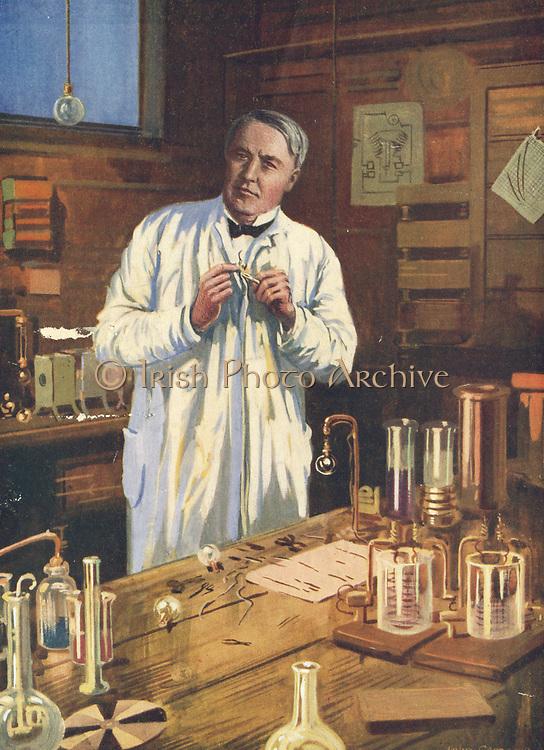 Thomas Alva Edison (1847-1931) American inventor, at work on incandescent light bulbs in his laboratory at Menlo Park.