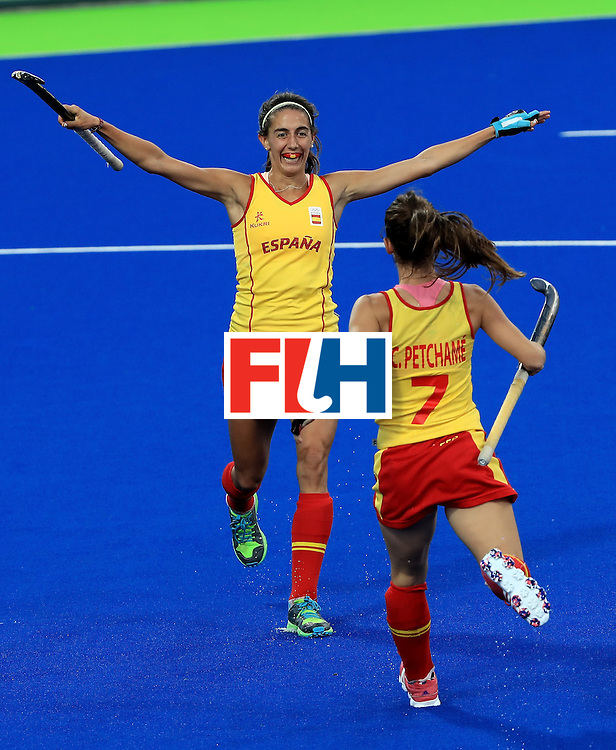 RIO DE JANEIRO, BRAZIL - AUGUST 11:  Carlota Petchame #7 of Spain congratulates Carola Savatella #8 following a goal during a Women's Preliminary Pool A match against Germany at the Olympic Hockey Centre on August 11, 2016 in Rio de Janeiro, Brazil.  (Photo by Sam Greenwood/Getty Images)