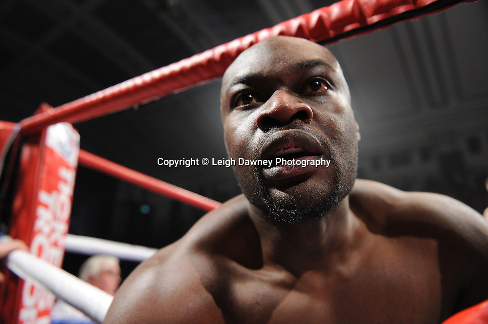 BBBofC Southern Area Heavyweight Title. Larry Olubamiwo falls through the ropes after a blow from John McDermott at York Hall, Bethnal Green, London on the 19th February 2011. Frank Warren Promotions. Photo credit © Leigh Dawney.
