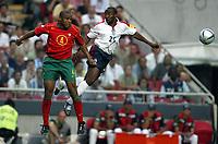 Fotball<br /> Euro 2004<br /> Portugal<br /> 24. juni 2004<br /> Foto: Dppi/Digitalsport<br /> NORWAY ONLY<br /> Kvartfinale<br /> Portugal v England<br /> JORGE ANDRADE (POR) / DARIUS VASSELL (ENG)