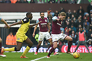 Aston Villa midfielder Birkir Bjarnason (20) clears from Burton Albion striker Lucas Akins (10) during the EFL Sky Bet Championship match between Aston Villa and Burton Albion at Villa Park, Birmingham, England on 3 February 2018. Picture by Richard Holmes.