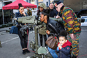 Brussels, Belgium 20160313 The Royal Belgian Military Academy had its yearly open day in Etterbeek, Brussels.The Royal Military Academy is a military institution of university education responsible for the basic academic, military and physical training of future officers.Mother with child looking through an enormous weapon