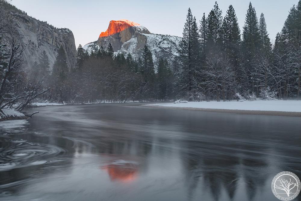 Last light illuminates Half Dome. Yosemite National Park, CA.