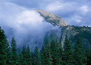 A late afternoon storm passes over Half Dome in Yosemite.