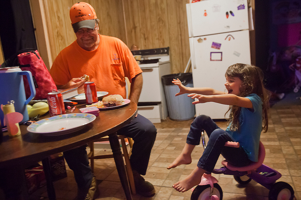 Kiera squirmed and giggled while eating dinner with Dale May 14. Dale, who said he isn't much of a cook but does his best, had made a family favorite called fat burgers, which are hand made hamburger patties.