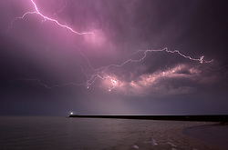 © Licenced to London News Pictures. 19-07-2017. Newhaven, East Sussex. Dramatic lightning display over Newhaven Lighthouse as summer storms sweep in from the English Channel. Photo credit: Peter Cripps/LNP